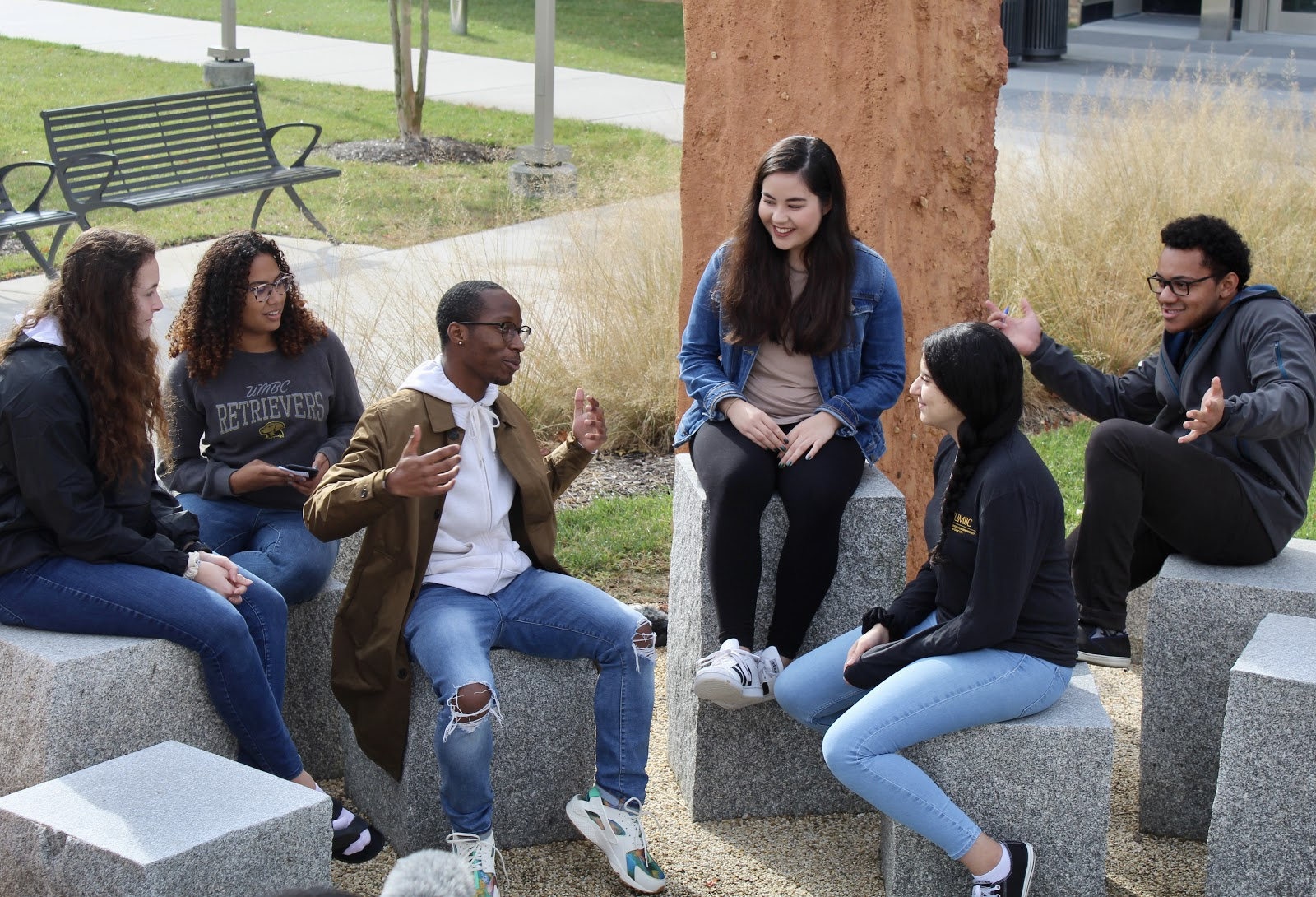 Students engaging in conversation outside